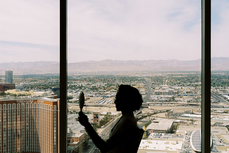 Getting ready on the Strip - a room with a view is a must for getting ready in Las Vegas. retro-inspired hair and make-up for an intimate wedding at the Neon Museum in Las Vegas - Kristen Kay Photography - Photo and Super 8 Video