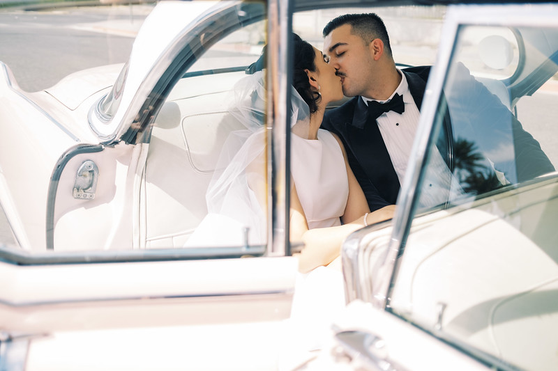 vintage Neon Museum wedding in Downtown Las Vegas - kissing in the back of Elvis' pink Cadillac  - Kristen Kay Photography - Photo and Super 8 Video