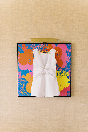 white bridal jumpsuit with pockets - designed by Alexia Maria - modern white romper with large bow on the back -Kristen Kay Photography - Photo and Super 8 Video