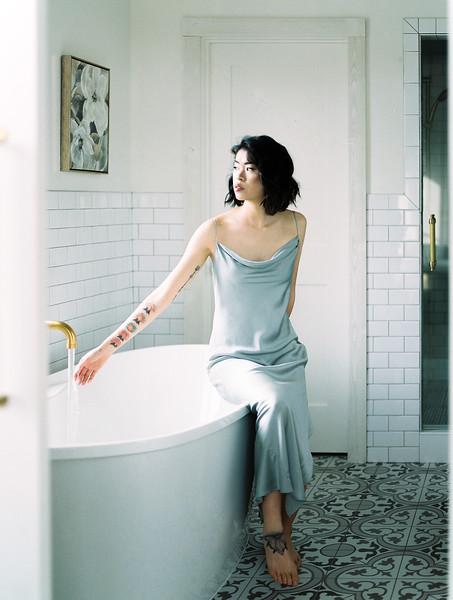 farmhouse modern bathroom inspiration with gold fixtures and floral art // editorial, boudoir lifestyle session | Kristen Krehbiel - Kristen Kay Photography - Southern California Lifestyle Photographer | Belle Lumiere & Amber Reverie Design