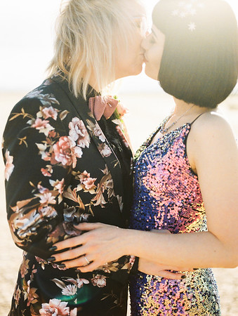 multi-colored, sequin, fitted, unconventional wedding gown and deep plum floral suit - Las Vegas Elopement at sunrise  - colorful, artistic, and unconventional desert elopement - Kristen Krehbiel - Kristen Kay Photography - Las Vegas Wedding and Elopement Photographer - beautiful lesbian elopement inspiration