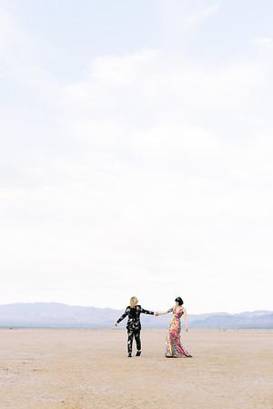 Las Vegas dry lake bed elopement at sunrise - multi-colored, sequin, fitted, unconventional wedding gown and deep plum floral suit - colorful, artistic, and unconventional desert elopement inspiration - Kristen Krehbiel - Kristen Kay Photography - Las Vegas Wedding and Elopement Photographer