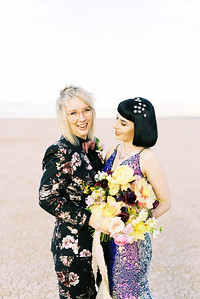 Las Vegas dry lake bed elopement at sunrise - yellow peony bridal bouquet with purple ranunculus - multi-colored, sequin, fitted, unconventional wedding gown and deep plum floral suit - colorful, artistic, and unconventional desert elopement inspiration - Kristen Krehbiel - Kristen Kay Photography - Las Vegas Wedding and Elopement Photographer