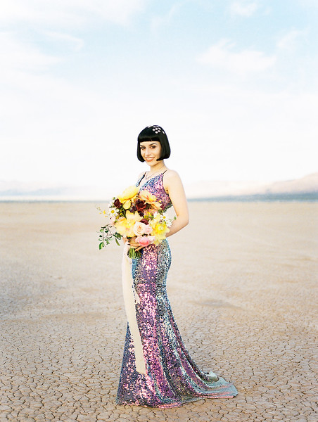 yellow peony bridal bouquet with purple ranunculus - Las Vegas dry lake bed elopement at sunrise - multi-colored, sequin, fitted, unconventional wedding gown and deep plum floral suit - colorful, artistic, and unconventional desert elopement inspiration - Kristen Krehbiel - Kristen Kay Photography - Las Vegas Wedding and Elopement Photographer