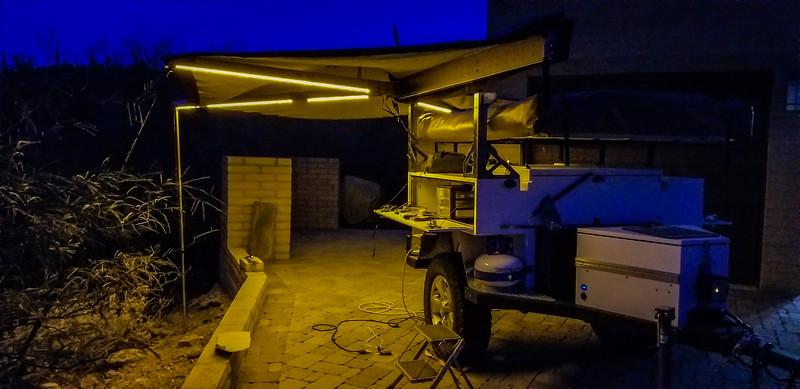 AluCab Shadow Awn amber LED lighting - Front Angle