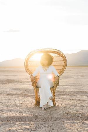 KRISTEN KAY PHOTOGRAPHY | Peacock Chair, Boho Glam Goddess | Dry Lake Bed Las Vegas Desert Elopement | XOXO Jamelle Wedding