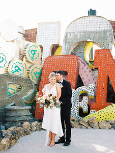 The Neon Museum - a unique Las Vegas wedding venue //  Kristen Krehbiel - Kristen Kay Photography // Bouquet by Cultivate Goods // black tux and knee length bridal gown // #bouquet #colorful #classic #artichoke