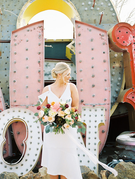 The Neon Museum - a colorful Las Vegas wedding venue //  Kristen Krehbiel - Kristen Kay Photography // Bouquet by Cultivate Goods // knee length white bridal gown #bouquet #colorful #classic