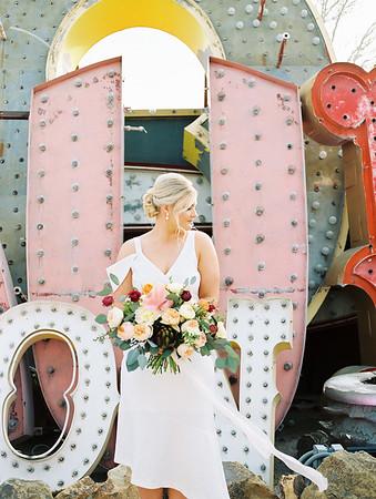The Neon Museum - a colorful Las Vegas wedding venue //  Kristen Krehbiel - Kristen Kay Photography // Bouquet by Cultivate Goods // knee length white bridal gown #bouquet #colorful #classic