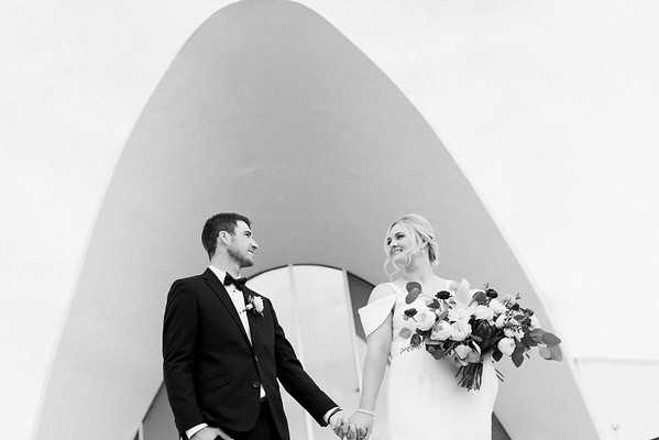 The Neon Museum - a mid century modern, unique Las Vegas elopement venue //  Kristen Krehbiel - Kristen Kay Photography // Bouquet by Cultivate Goods // black tux and knee length wedding gown with sleeve // #bouquet #classic #midmod