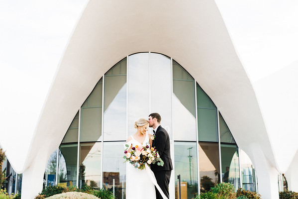 The Neon Museum - a mid century modern, unique Las Vegas wedding venue //  Kristen Krehbiel - Kristen Kay Photography // Bouquet by Cultivate Goods // black tux and knee length gown // #bouquet #colorful #classic