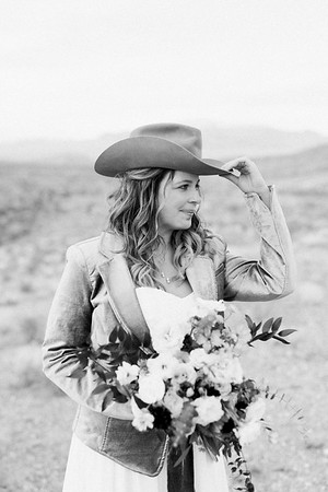 bride in grandfather's cowboy hat - a meaningful, special moment for the bride // Las Vegas desert elopement in the mountains // Kristen Krehbiel - Kristen Kay Photography
