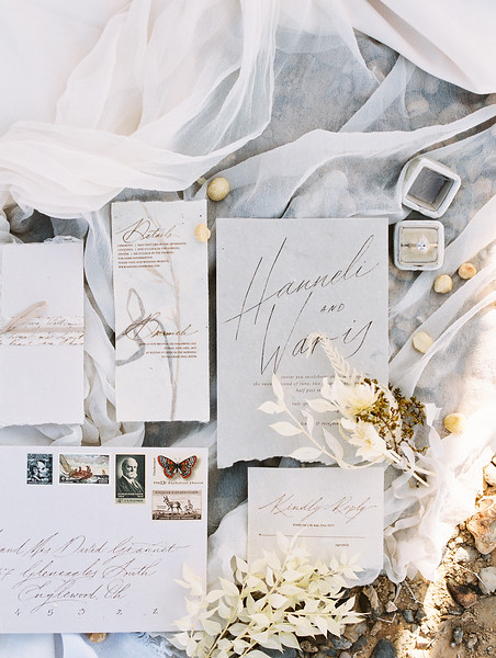 white and grey calligraphy wedding invitation suite with old stamps // Janna Brown Design // Kristen Krehbiel - Kristen Kay Photography - sunrise desert elopement in Las Vegas