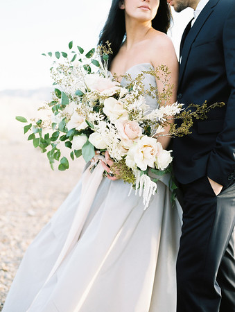 Las Vegas Elopement at Sunrise  //  oversized organic bridal bouquet with desert plants, white garden roses and blush pink roses  // Janna Brown Design // Kristen Krehbiel - Kristen Kay Photography