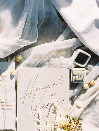 teardrop diamond ring // white and grey calligraphy wedding invitation suite with old stamps // Janna Brown Design // Kristen Krehbiel - Kristen Kay Photography - sunrise desert elopement in Las Vegas