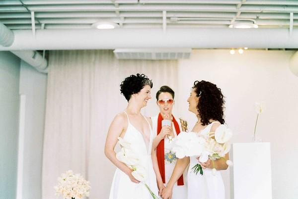 Elvis Officiant - Las Vegas Wedding Chapel - modern, minimal, natural light wedding chapel - Kristen Kay Photography - Kristen Krehbiel - Sure Thing Chapel - tulip and rose neutral floral bouquet - #chapel #lasvegas #loveislove