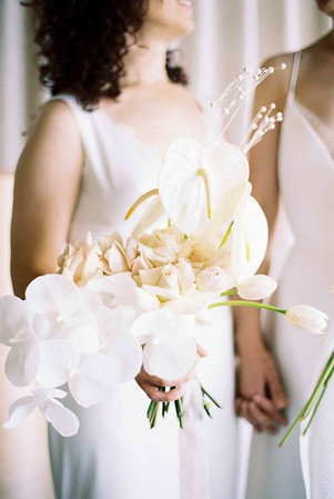 rose, anthurium and white orchid bouquet -A modern elopement for two brides - Las Vegas elopement wedding chapel - modern, minimal, natural light wedding chapel - Kristen Kay Photography - Kristen Krehbiel - Sure Thing Chapel