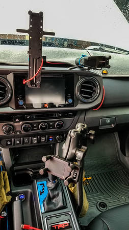 Tablet and passenger phone mount attached the The Taco Garage digital multi mount using Hondo Garage Big Squeeze and Phone Squeeze mounts. Power from glovebox USB. Drivers phone on RAM mount arm using Hondo Garage phone squeeze mount.