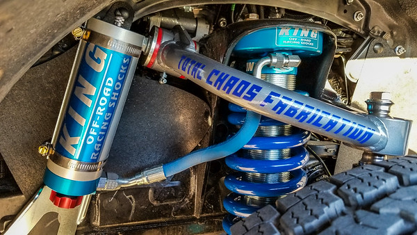 King adjustable reservoir coilover suspension, hydraulic bumpstops, Total Chaos upper control arm and Deaver U406 Expedition Stage 3 leaf springs