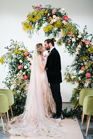 The Doyle - Las Vegas Wedding Venue - Kristen Krehbiel - Kristen Kay Photography - bright pink yellow and green artistic floral archway - Carol Hannah Gown - Marjorie