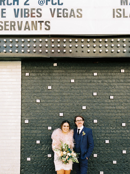 Downtown Las Vegas Signs - Neon Museum Las Vegas Wedding - Kristen Krehbiel - Kristen Kay Photography - blue suit and short long sleeve lace dress - view more ideas from this rad Elvis inspired intimate wedding in colorful, fun Downtown Vegas -- #neonmuseum #vintage #elopement #neon