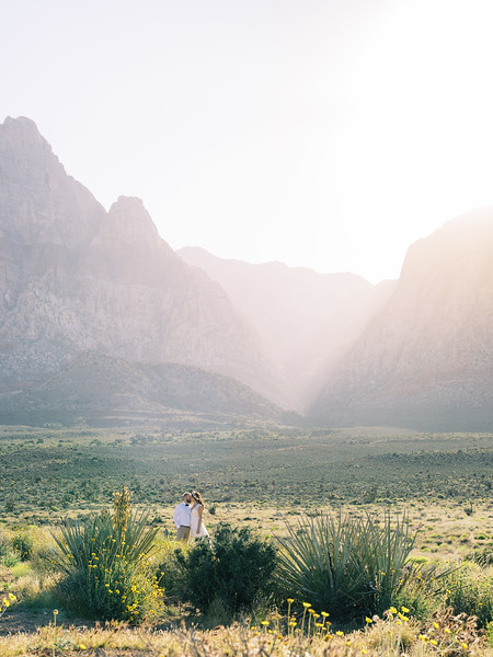 Red Rock Canyon Wedding Ceremony in Las Vegas - the most beautiful desert wedding location // Kristen Krehbiel - Kristen Kay Photography // Layers of Lovely floral crown with ranunculus and roses - lace open back wedding gown with bow // With Love Wedding Planning // Peachy Keen Unions