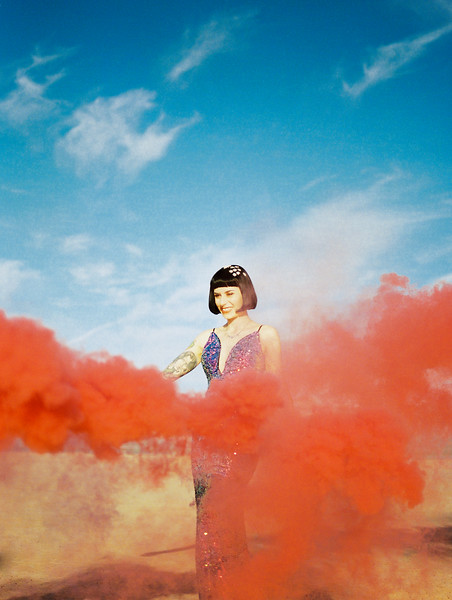red smoke bomb desert elopement - Las Vegas dry lake bed sunrise elopement - multi-colored, sequin, fitted, unconventional wedding gown - colorful, artistic, and unconventional desert elopement inspiration - Kristen Krehbiel - Kristen Kay Photography - Las Vegas Wedding and Elopement Photographer
