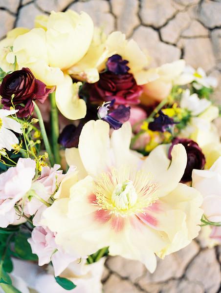 yellow peony bridal bouquet with purple ranunculus - Las Vegas dry lake bed elopement at sunrise - colorful, artistic, and unconventional desert elopement inspiration - Kristen Krehbiel - Kristen Kay Photography - Las Vegas Wedding and Elopement Photographer