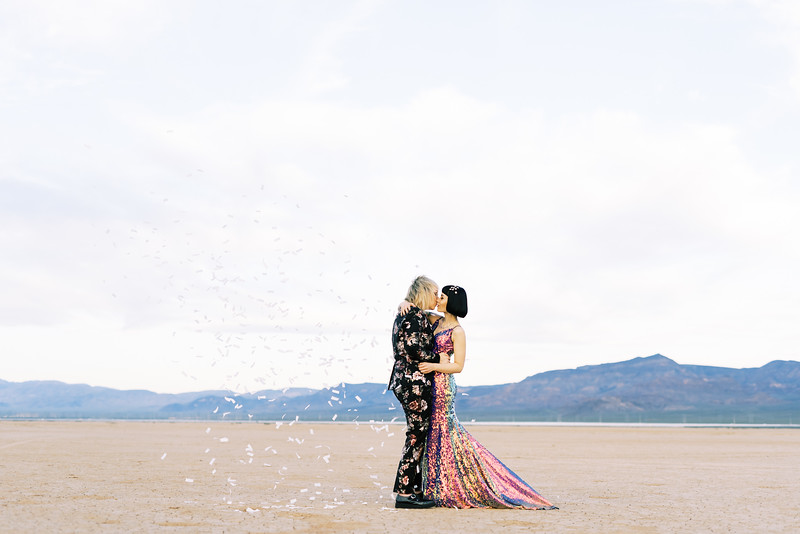 rice paper confetti celebration - multi-colored, sequin, fitted, unconventional wedding gown and deep plum floral suit - Las Vegas dry lake bed elopement at sunrise - colorful, artistic, and unconventional desert elopement - Kristen Krehbiel - Kristen Kay Photography - Las Vegas Wedding and Elopement Photographer - artsy elopement inspiration