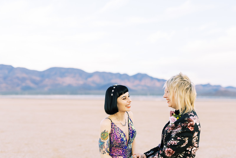 multi-colored, sequin, fitted, unconventional wedding gown and deep plum floral suit - Las Vegas dry lake bed elopement at sunrise - colorful, artistic, and unconventional desert elopement - Kristen Krehbiel - Kristen Kay Photography - Las Vegas Wedding and Elopement Photographer - artsy elopement inspiration