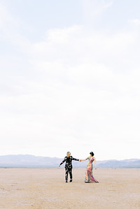 Las Vegas dry lake bed elopement at sunrise - multi-colored, sequin, fitted, unconventional wedding gown and deep plum floral suit - colorful, artistic, and unconventional desert elopement inspiration - Kristen Krehbiel - Kristen Kay Photography - Las Vegas Wedding and Elopement Photographer