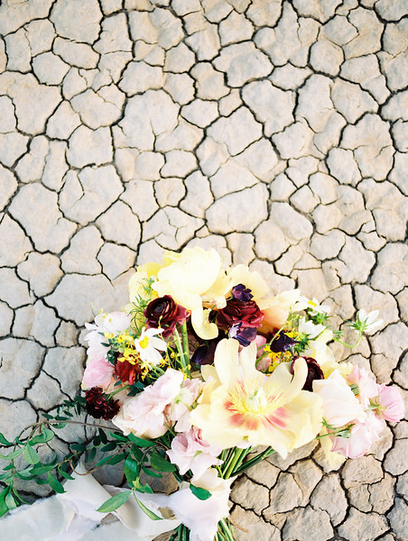 yellow peony bridal bouquet with purple ranunculus - Las Vegas dry lake bed elopement at sunrise - colorful, artistic, and unconventional desert elopement inspiration - Kristen Krehbiel - Kristen Kay Photography - Las Vegas Wedding and Elopement Photographer