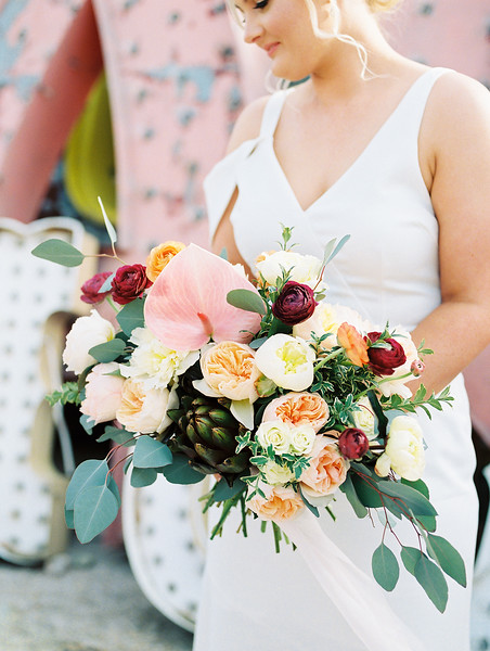 The Neon Museum - a colorful Las Vegas venue for a wedding photo session //  Kristen Krehbiel - Kristen Kay Photography // Florals by Cultivate Goods // #bouquet #artichoke #uniquebouquet #modern