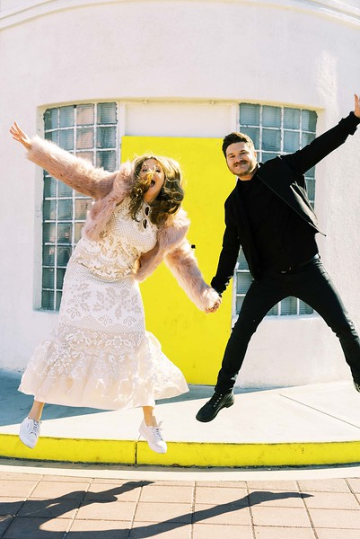 View all the fun elopement ideas for your one-of-a-kind Downtown Las Vegas Elopement | Kristen Kay Photography - Las Vegas Elopement photographer and Super 8 videographer | #elopement #pinkfur #jumping #yellowdoor #downtown
