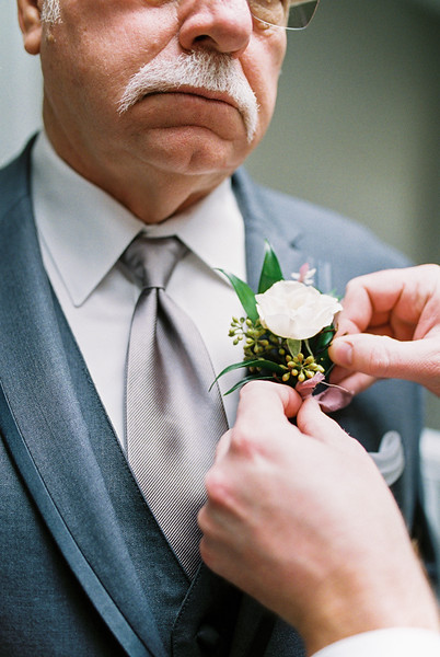 white boutonniere for father of the groom - Rooted Willow // Las Vegas Elopement & Intimate Wedding Photographer - Kristen Krehbiel - Kristen Kay Photography