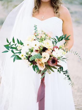 bridal bouquet with protea, scabiosa, eucalyptus and garden roses - Rooted Willow // romantic Las Vegas desert elopement // Las Vegas Elopement & Intimate Wedding Photographer - Kristen Krehbiel - Kristen Kay Photography