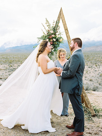 triangle arch with protea, eucalyptus, garden roses for outdoor intimate wedding ceremony // Las Vegas officiant, celebrant - Peachy Keen Unions //  mountainous, winter, adventure desert elopement // Las Vegas Elopement & Intimate Wedding Photographer - Kristen Krehbiel - Kristen Kay Photography