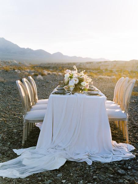 Janna Brown Design table setting // Kristen Krehbiel - Kristen Kay Photography // blush linens with blue accents desert elopement at sunrise in Las Vegas