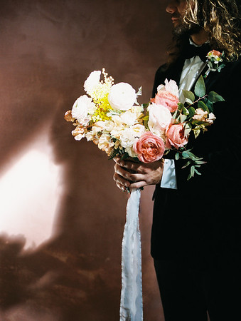 Black suit with bow tie - classic groom style - harsh light portrait - The Doyle - Las Vegas Wedding Venue - Kristen Krehbiel - Kristen Kay Photography - pink peony and white bridal bouquet by Oak and Owl