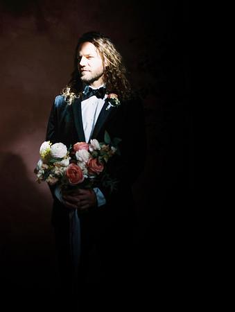 Black suit with bow tie - classic groom style - harsh light portrait - The Doyle - Las Vegas Wedding Venue - Kristen Krehbiel - Kristen Kay Photography - pink and white bridal bouquet by Oak and Owl