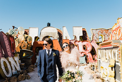 Neon Museum Las Vegas Wedding - Unique Wedding Locations - Kristen Kay Photography - long sleeve floral lace dress with fur - view more from this rad, vintage Elvis inspired intimate wedding in colorful and fun Downtown Vegas -- #neonmuseum #vintage #elopement #neon #suit #feathers