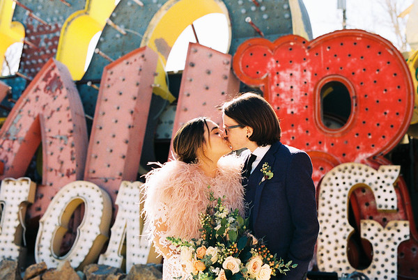 Neon Museum Las Vegas Elopement - Unique Wedding Locations - Kristen Kay Photography - blue suit and short long sleeve lace dress - view more from this rad Elvis inspired intimate wedding in colorful, fun Downtown Vegas -- #neonmuseum #vintage #elopement #neon #color
