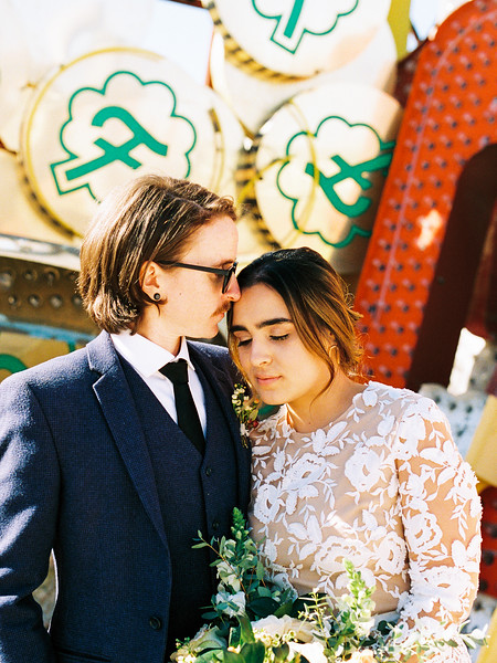 Neon Museum Las Vegas Wedding - Kristen Krehbiel - Kristen Kay Photography - blue suit and short long sleeve floral lace dress - view more ideas from this rad Elvis inspired intimate wedding in colorful, fun Downtown Vegas -- Featured on Bridal Musing - #neonmuseum #vintage #elopement #neon