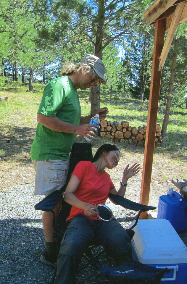 Poor Chiyoko! This happened on our camping trip last Summer, our friend Nancy just sent us the photos! Chiyoko's contact lens rolled up under her eye lid & she couldn't get it out! Dr. Meacham to the rescue with a bottle of water to flush it out with :^).