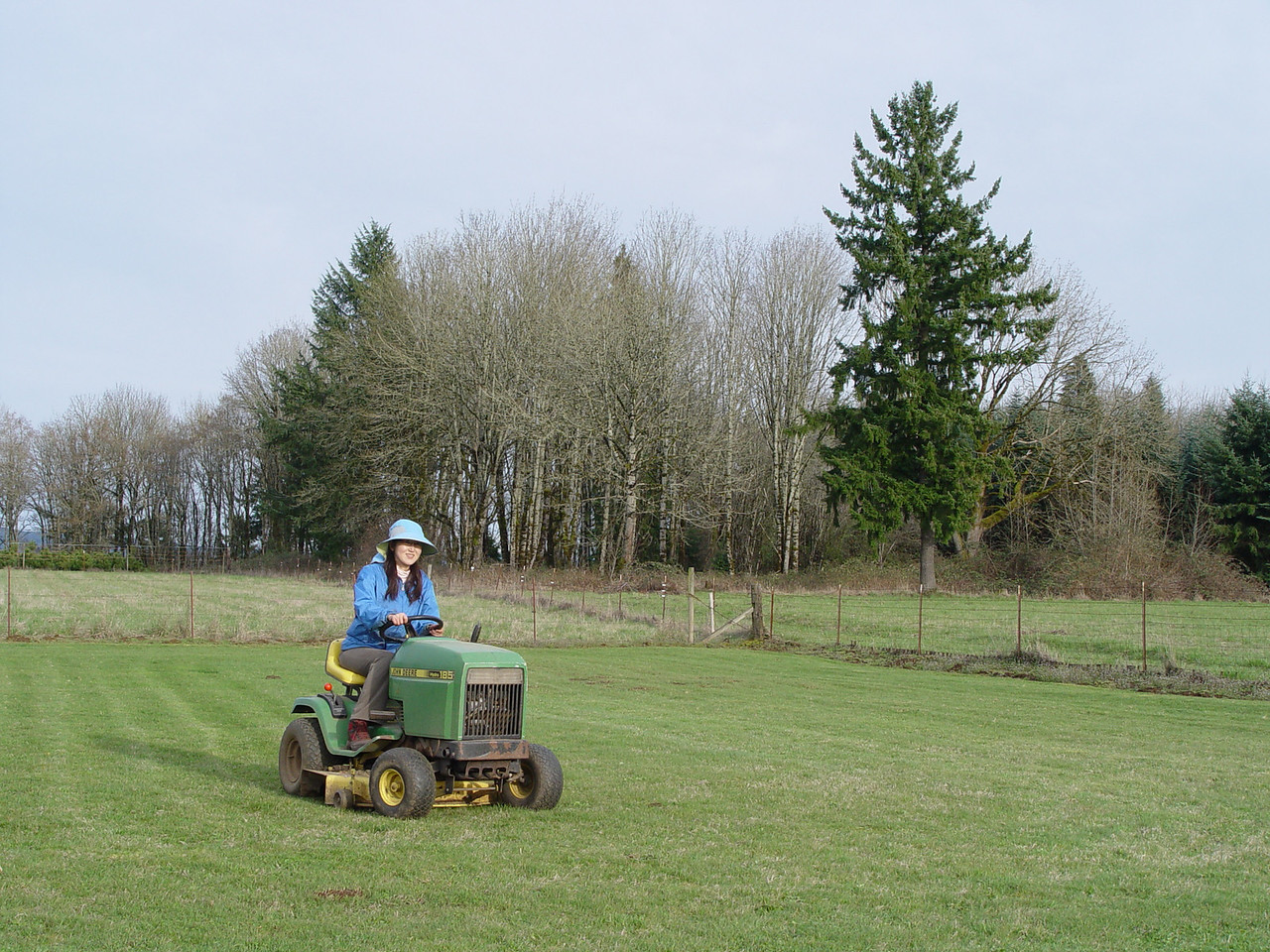 Chiyoko taking the mower for a spin in the back field