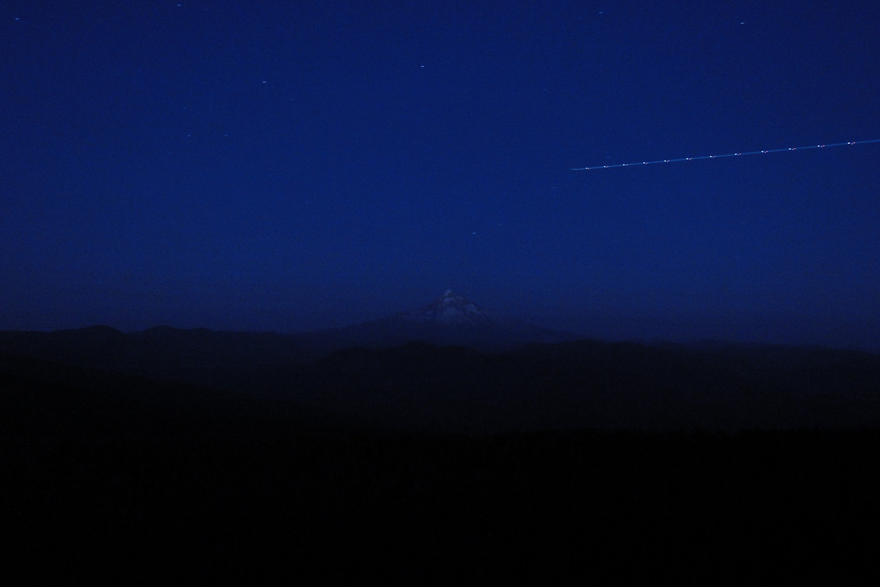 Thursday evening we went up to Larch Mountain to watch the Perseid meteor shower. There were quite a few people up there and more were coming when we headed for home at 11:00. No luck capturing one in a photo though so I had to make do with this photo of a plane instead :^)..