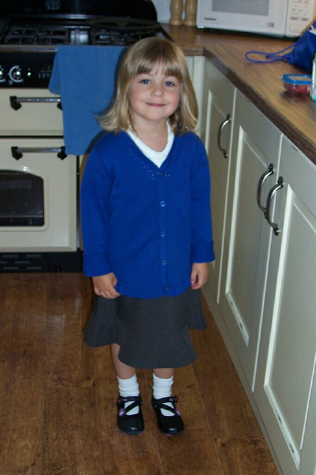 Dad sent us this picture of Maddy in her new school uniform.