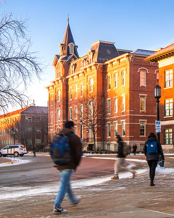 Students walking at sunrise in front of University Hall at Purdue on January 30th, 2017.