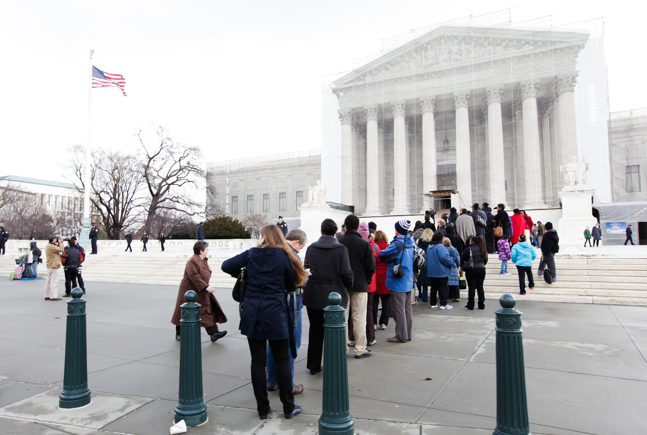 People wait outisde of the Supreme Court on Wednesday, February 27, 2013 to hear the case of Shelby County v. Holder Voting Rights.