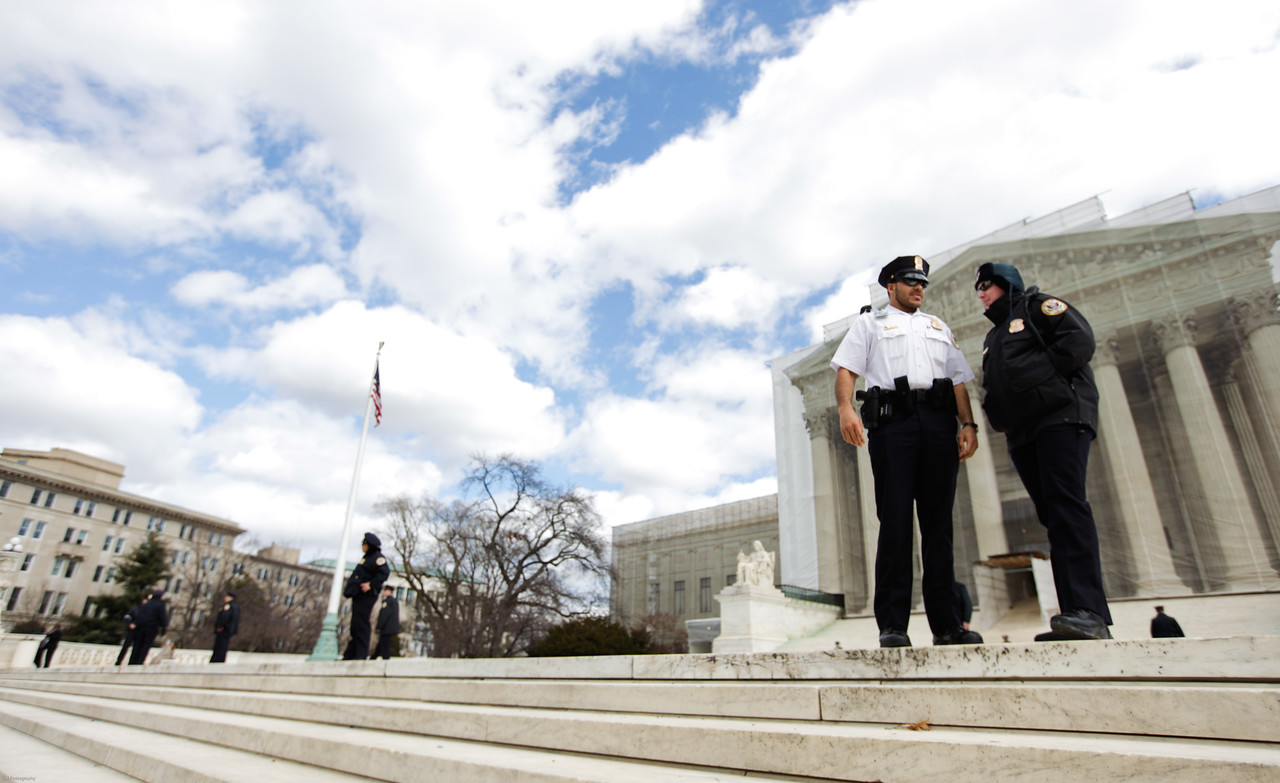 Officers stand outside of the Supreme Court on Wednesday, February 27, 2013 during the Shelby County vs. Holder.
